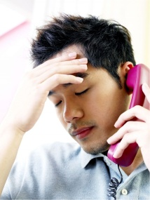 Man on phone stressing because his real estate investing strategies are not working